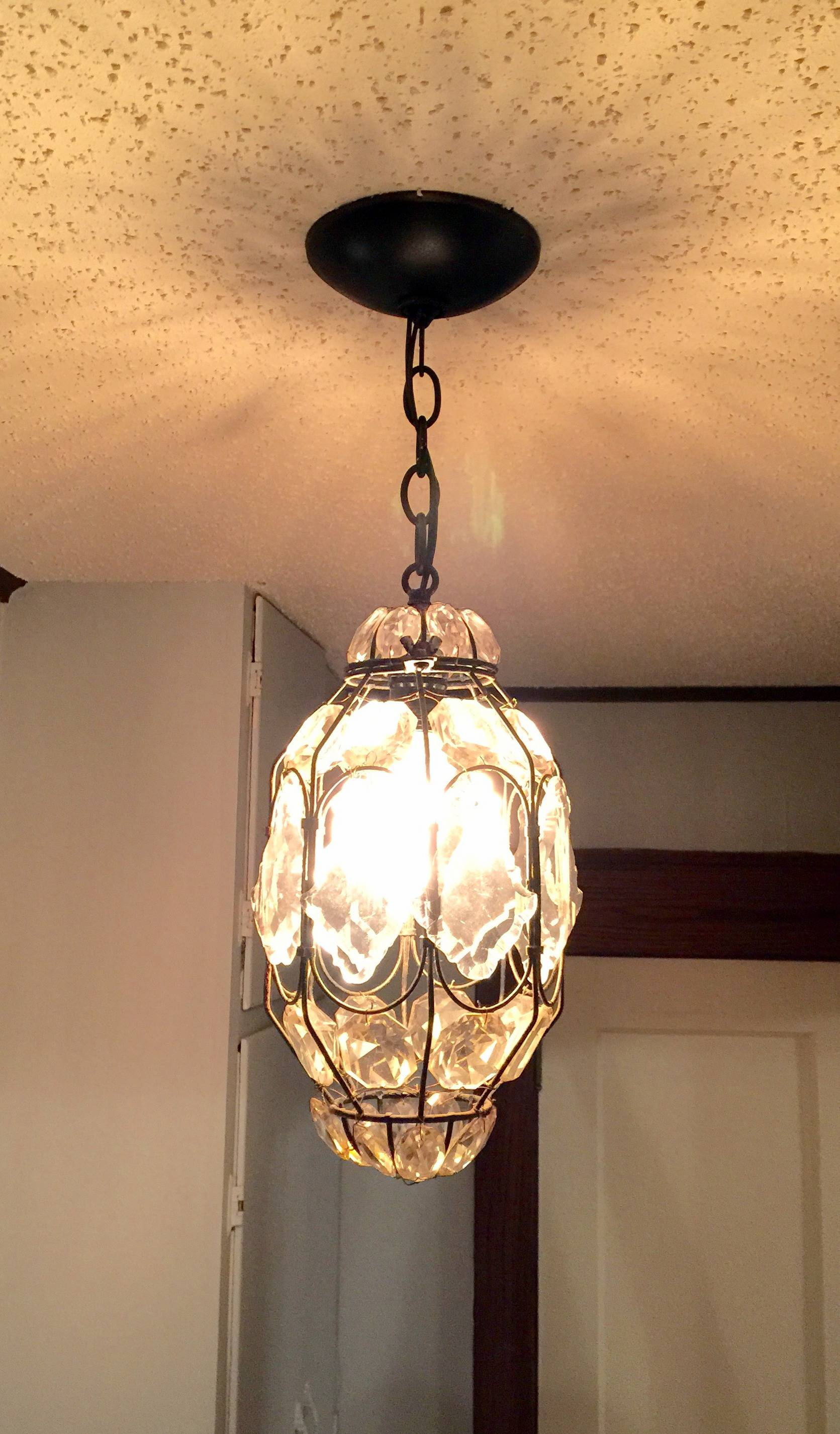Chandelier replacement in our first home on MostlySewing.com