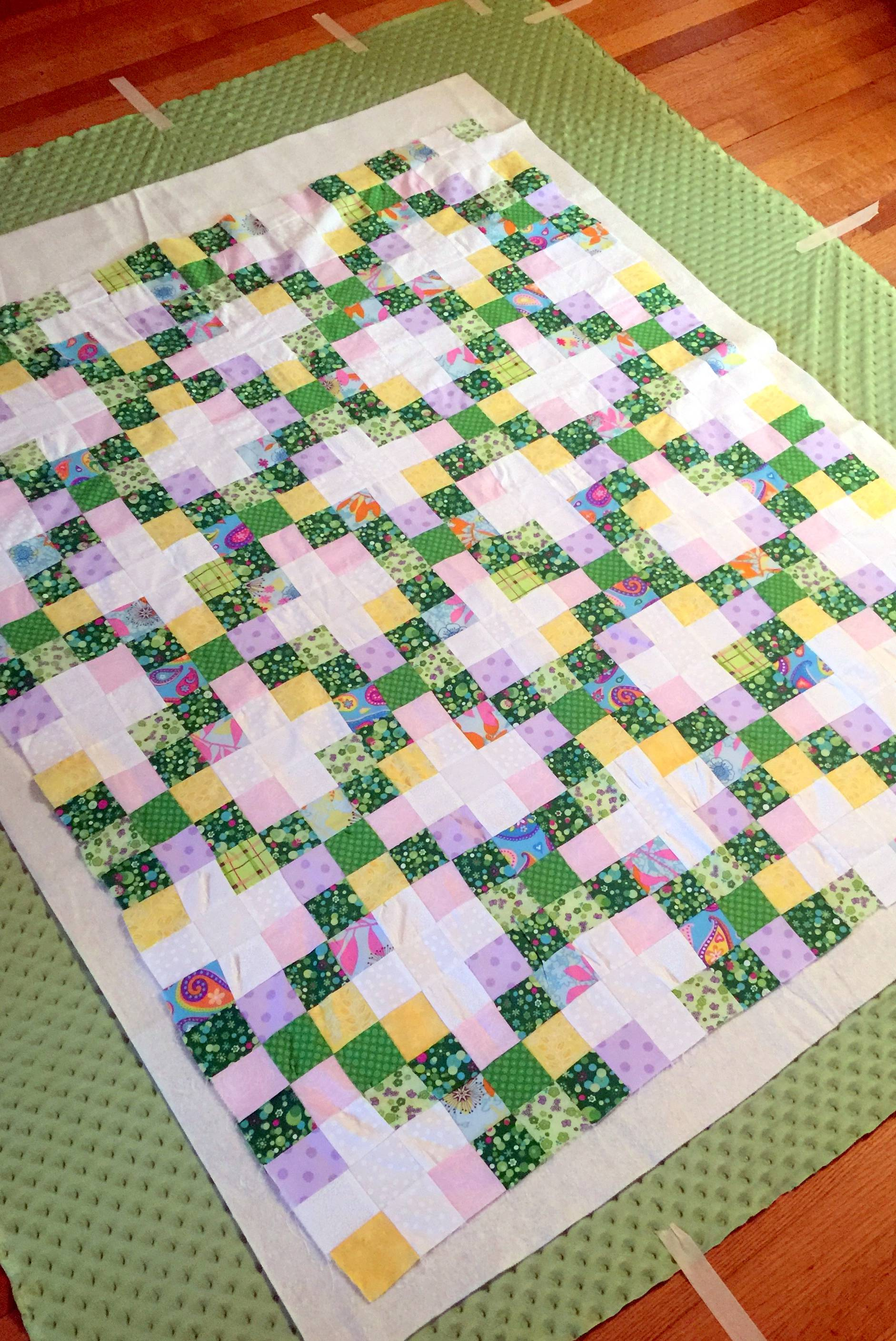 basting an irish chain baby quilt