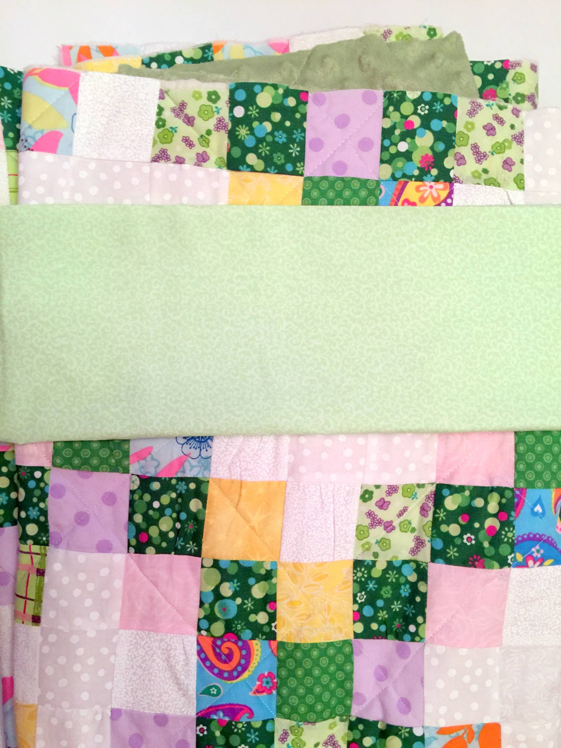 binding fabric for a green irish chain baby quilt