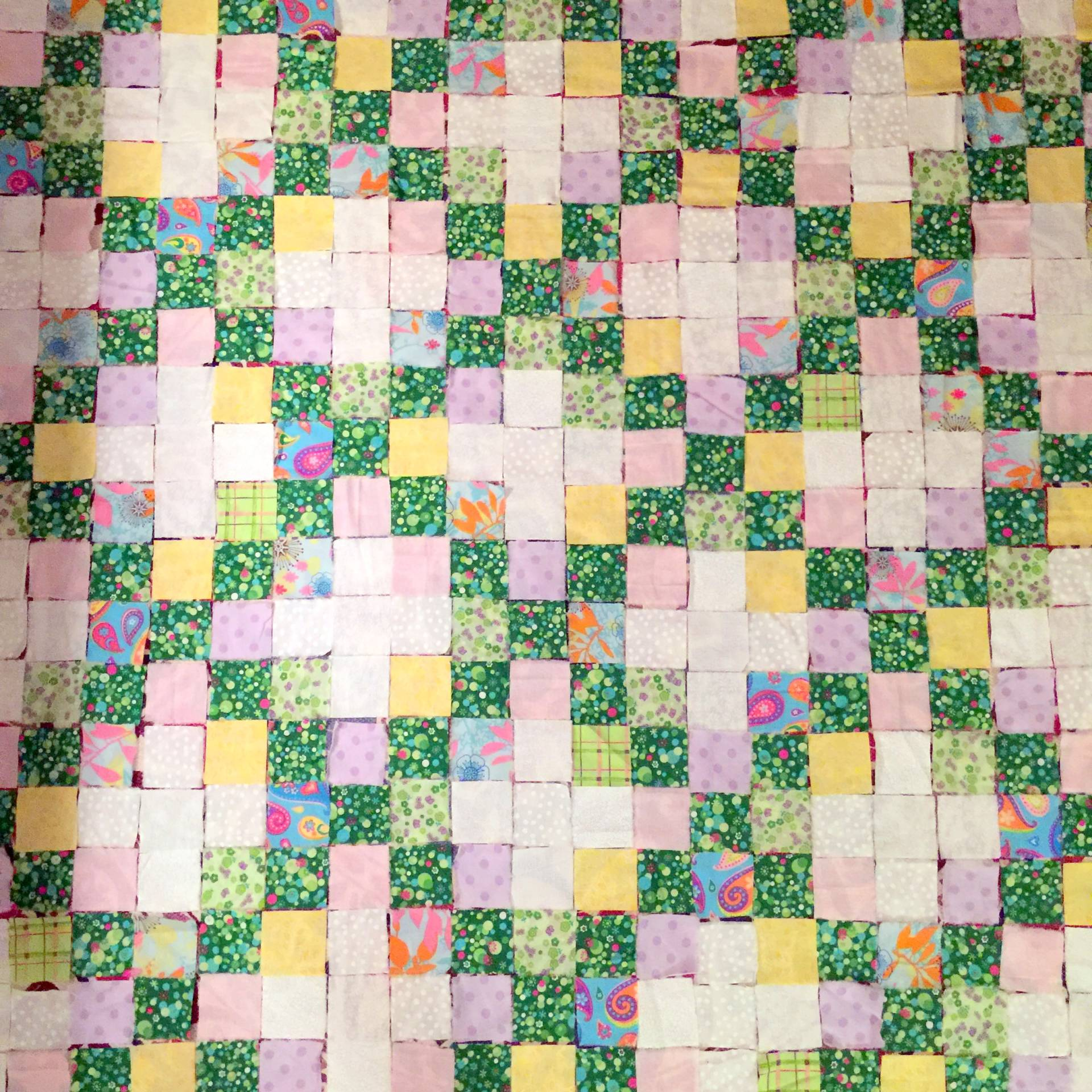 laying out squares for an irish chain quilt