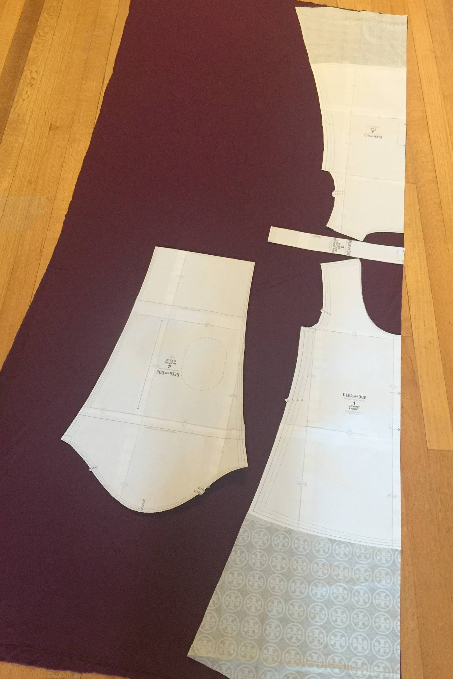 laying out the pattern on jersey knit fabric