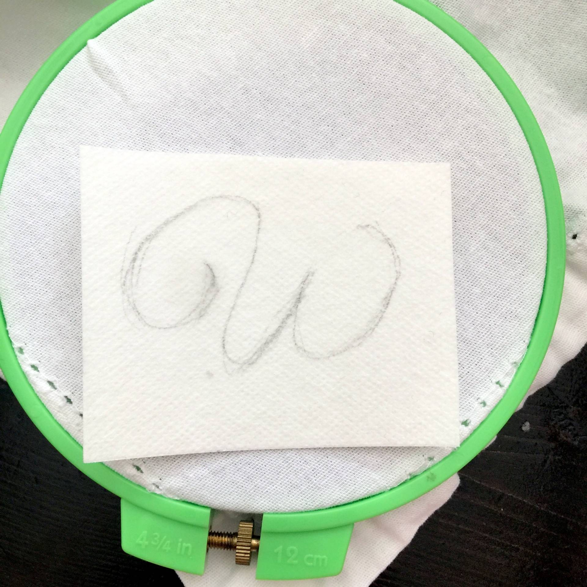 cut the paper to fit in the embroidery hoop