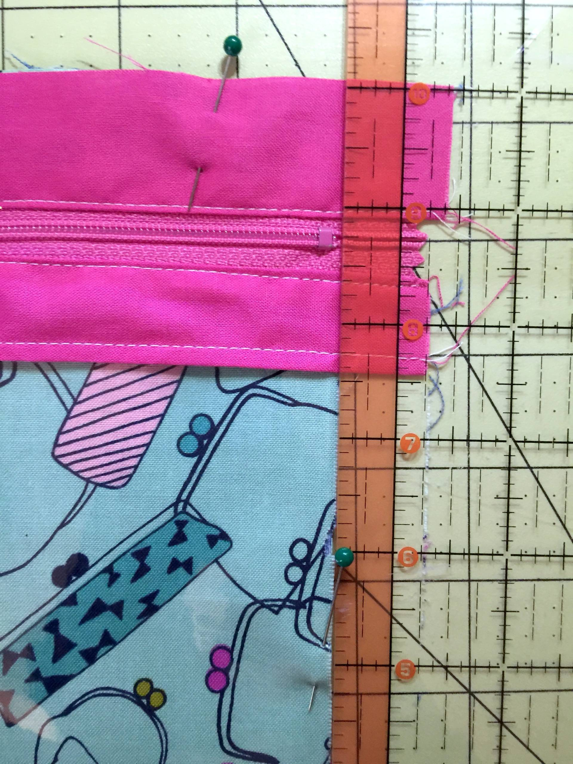 Vinyl Zip Pouch trimming the zipper to the width of the pouch