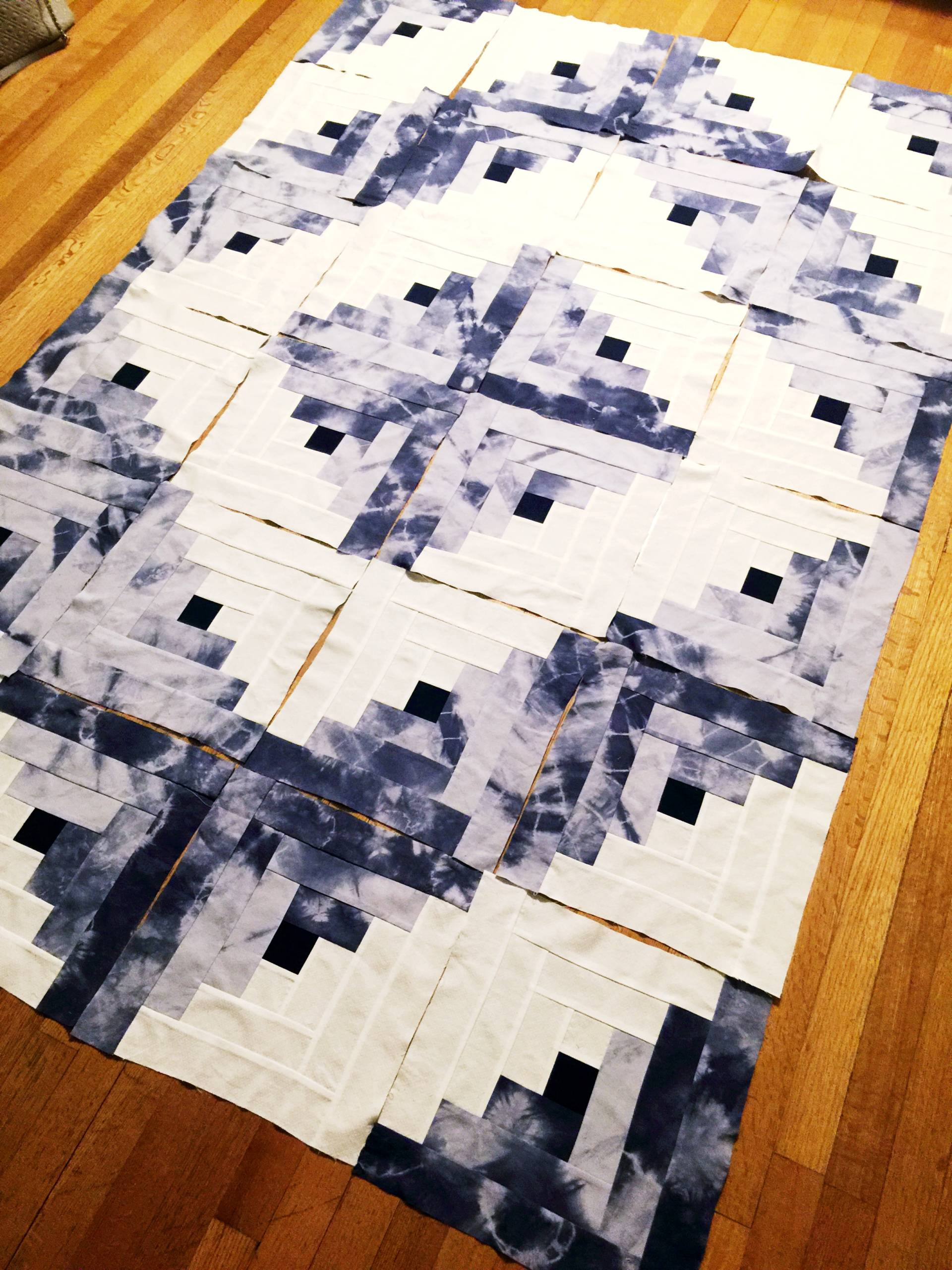 a barn raising style log cabin quilt layout