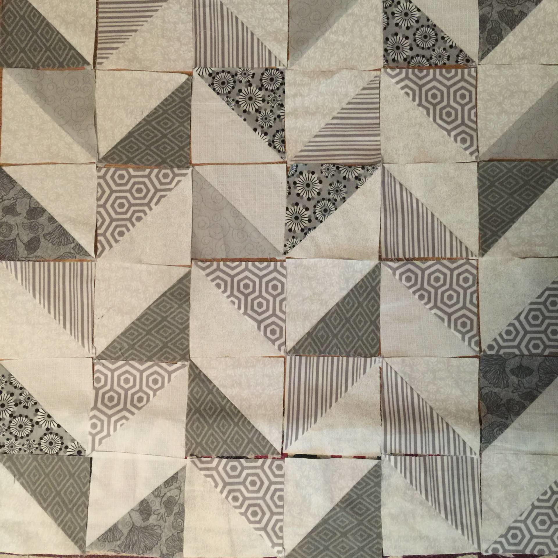 half square triangle layout in the herriingbone pattern for a pillow cover