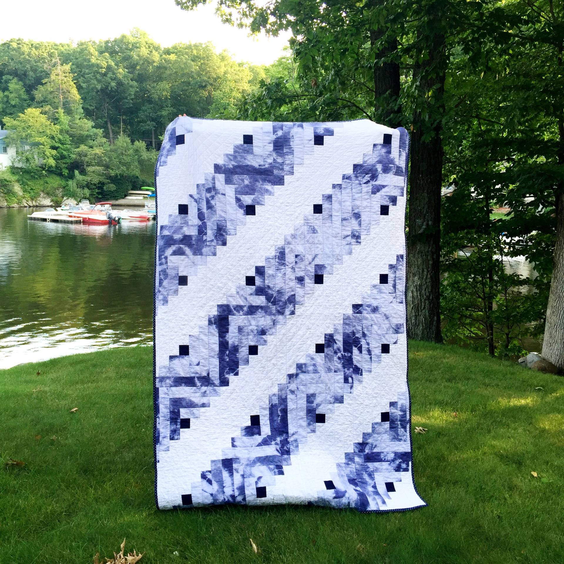 Finished shibori tie dye log cabin quilt