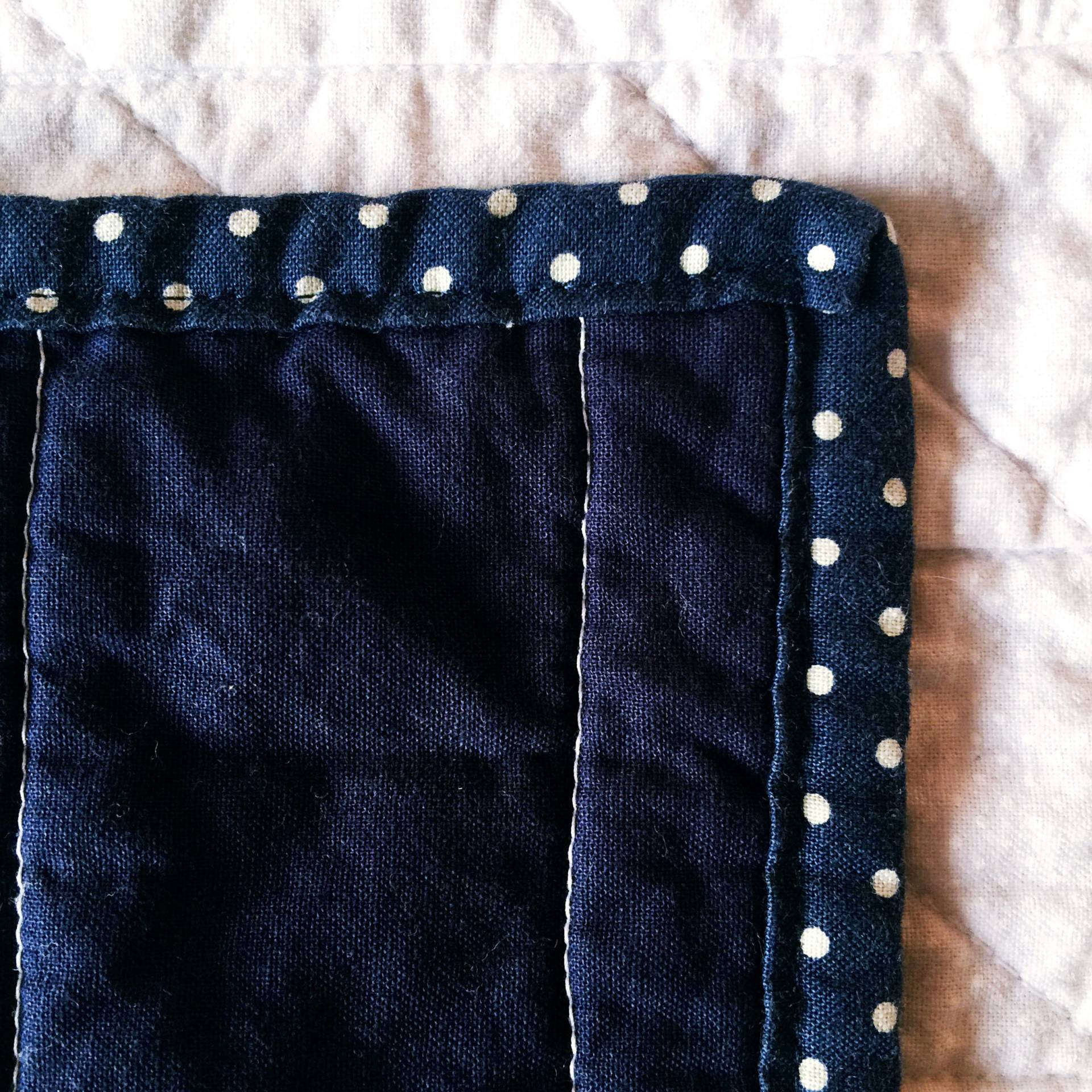 Using bias tape as binding worked really well for me this time! I definitely prefer it to the stitch i n the ditch method