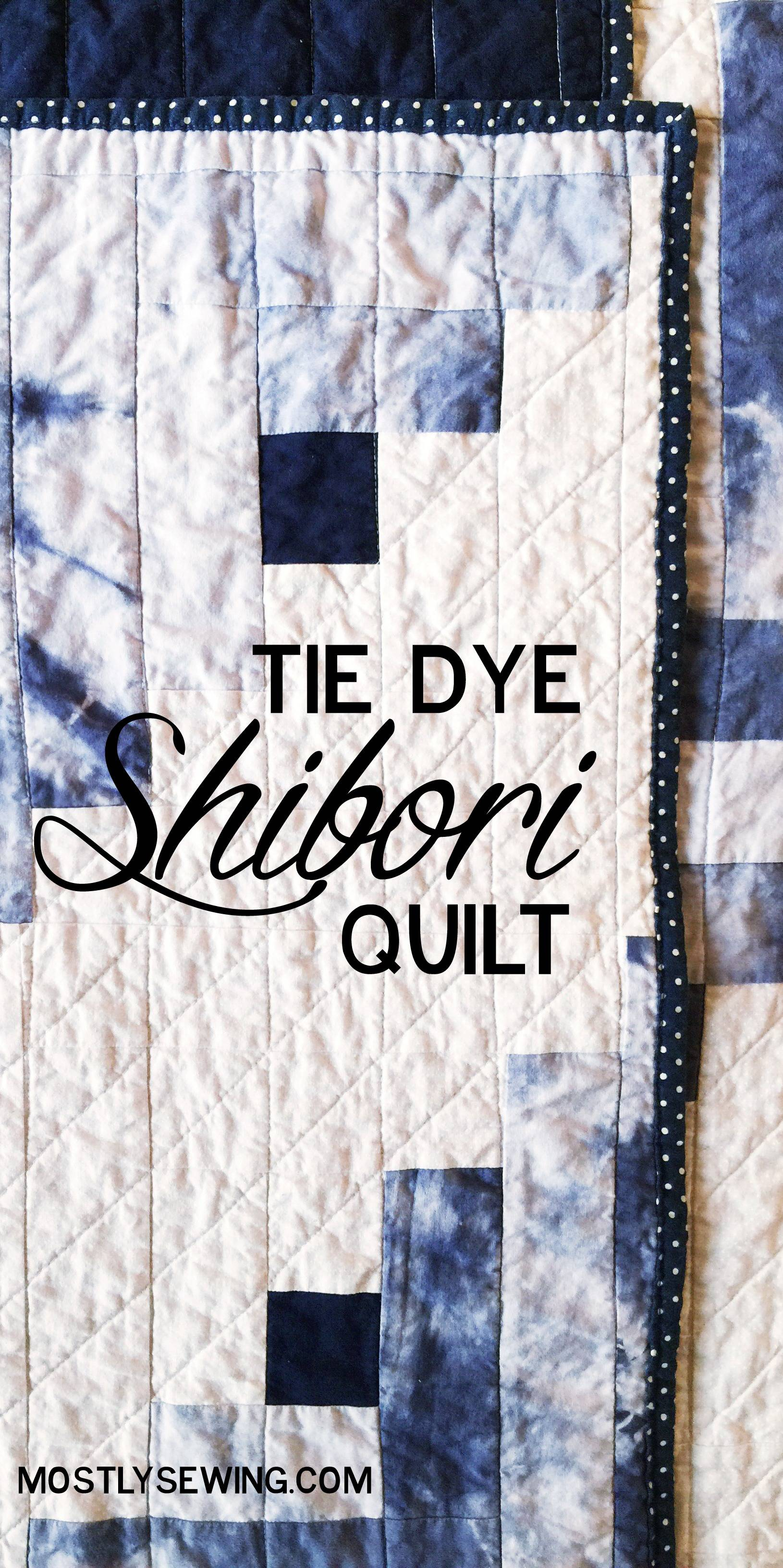 shibori log cabin quilt with hand dyed fabric