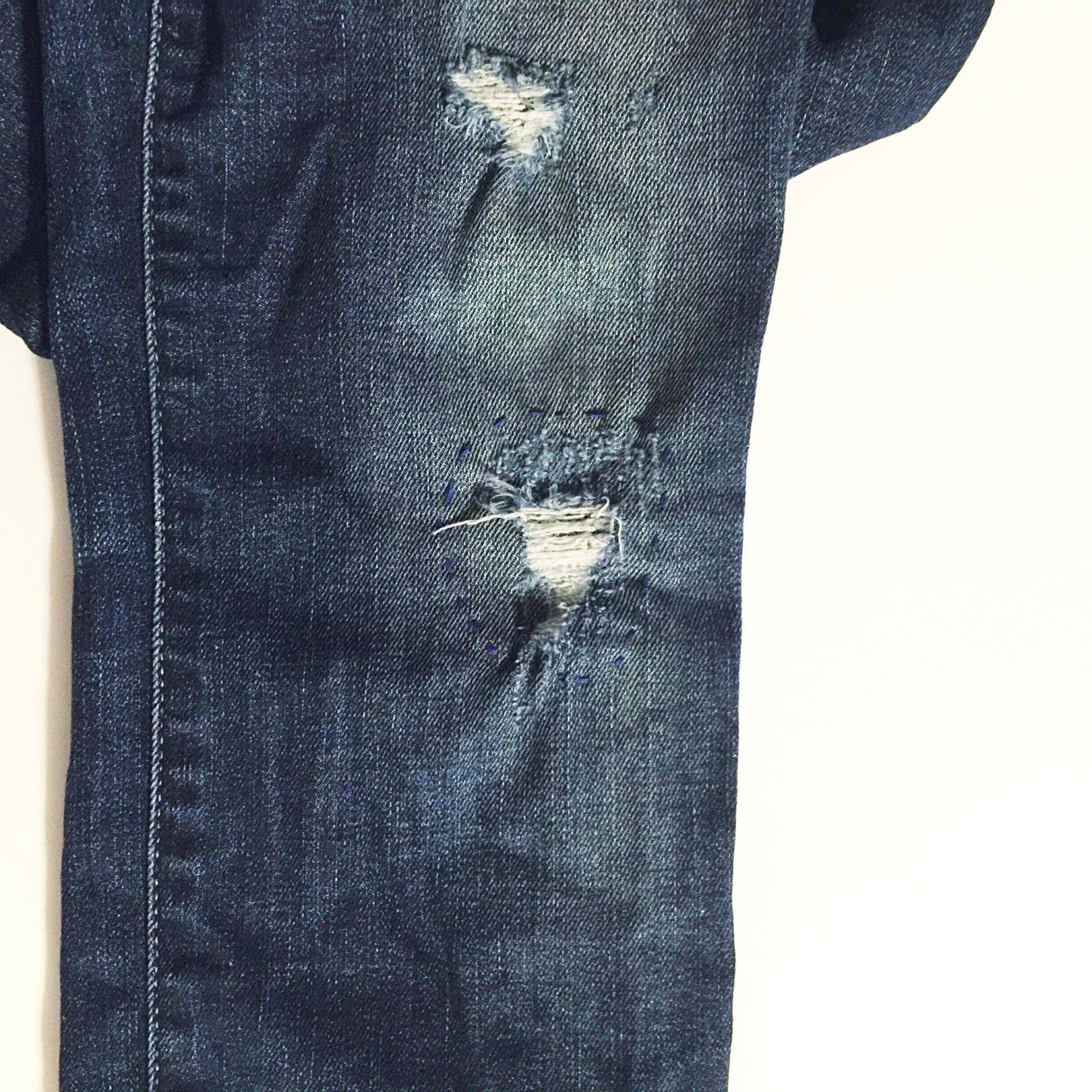 I lined a few overly-distressed spots with on my jeans with lace! Super simple project, and it looks really cute!