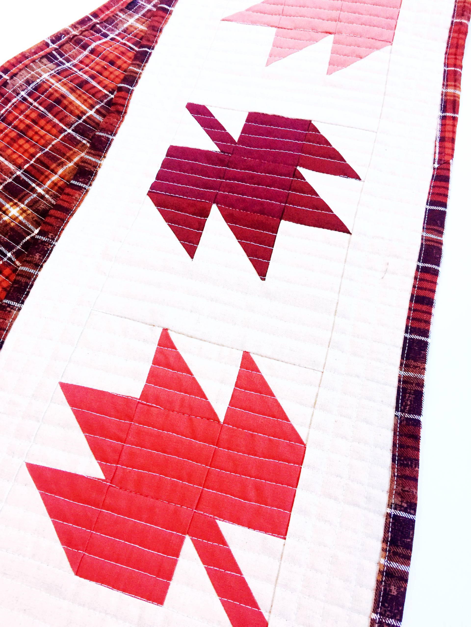 Autumn-themed table runner in solids with matchstick quilting