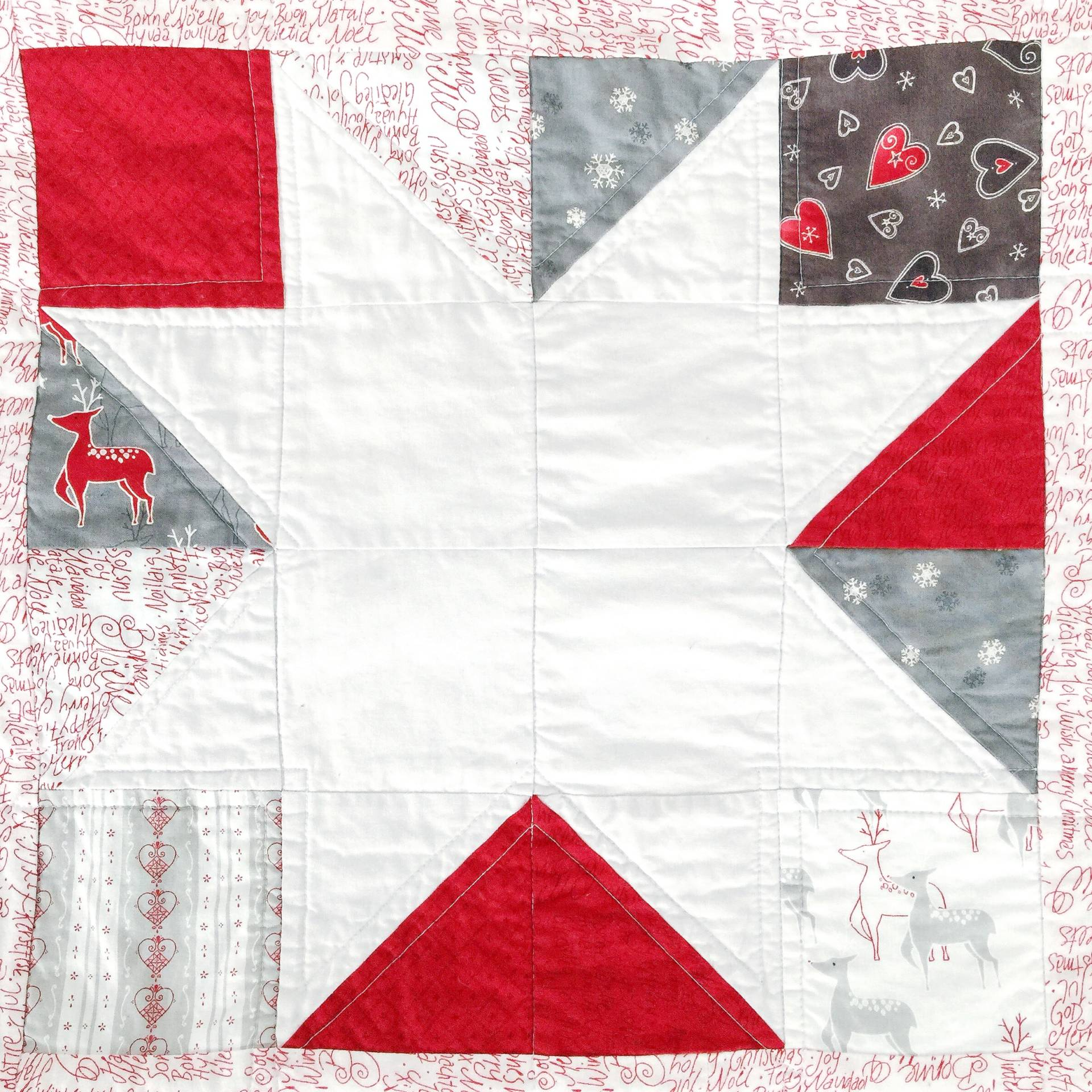 HST Triangle quilt from the Moda Jol charm pack! Obsessed with these little reindeer!