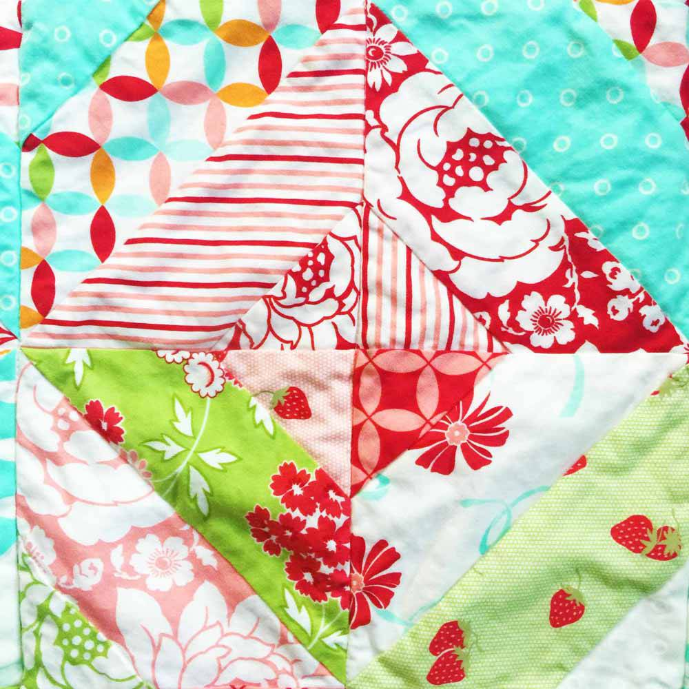 block in the garden trellis lap quilt jelly roll quilts by MostlySewing.com