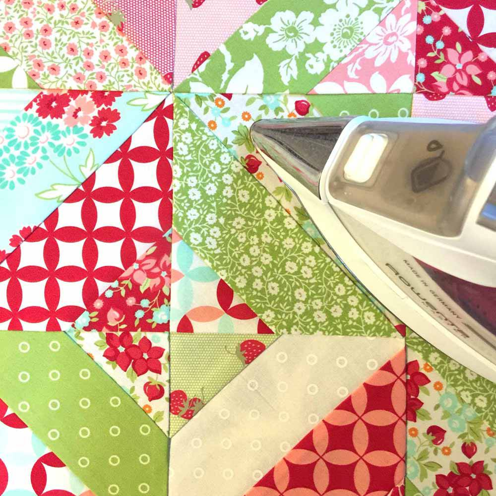 ironing perfect corners from the garden trellis lap quilt jelly roll quilts by MostlySewing.com